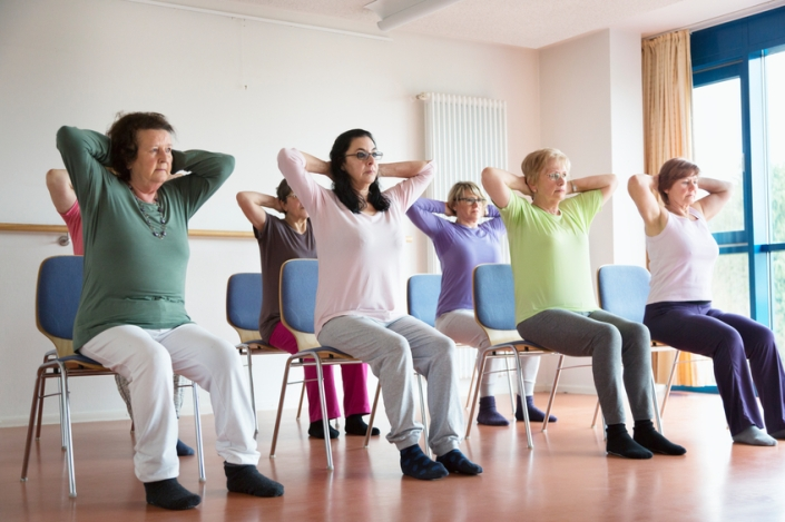 active senior women yoga class on chairs